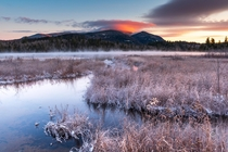 Volcanic Winter Lenticular clouds lit up during a wintry sunrise in the Adirondack Mountains NY