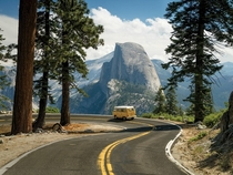 VW Camper Driving with a Beautiful View of Half Dome Yosemite National Park California   Chris Burkard