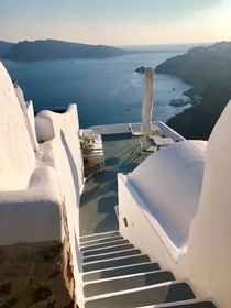 walking down the perfect steps of Santorini Greece