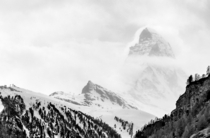 Walking down to Zermatt on the Matterhorn trail I looked up and saw the mountain in a shroud of clouds Like a ghost