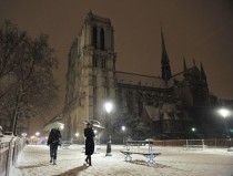 Walking through the snow near the Notre Dame in Paris