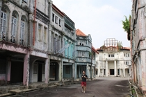 Wandering among these abandoned shophouses