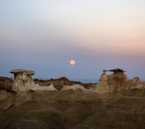 Watched the full moon set at sunrise over the otherworldly Bisti Badlands of New Mexico