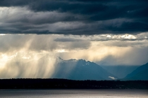 Watched this storm roll in over the Olympic Mountains from my window