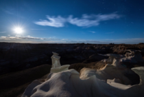 Watching the full harvest moon rise over the Bisti badlands in New Mexico was otherworldly