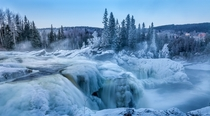 Water and ice Ristafallet Waterfall in Jamtland Sweden  Photo by Andreas Sandstrm xpost from rSwedenPics