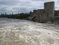 Water Churns Against Abandoned Factory Just Past Chaudire Falls Parliament in the Background