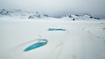 Water-filled potholes on the Black Rapids Glacier in the Alaska Range