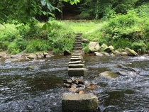 Water flowing through stepping stones at Hardcastle Crags National Park