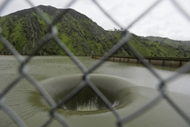 Water flows into the iconic Glory Hole spillway at Monticello Dam in Lake Berryessa California Water is flowing for the first time in over a decade into the -foot diameter hole due to the recent storms in California