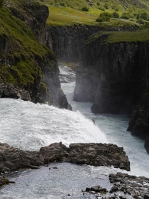 Water going over the edge of Gullfoss into the canyon below Iceland