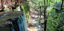 Waterfall flowing over a cliff deep in Allegheny National Forest - Pennsylvania Wilds