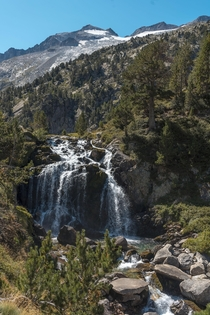 Waterfall in the aragon pyrenees Spain The Aneto the third highest mountain in Spain can be seen in the background ig carlosgmoyo OCx