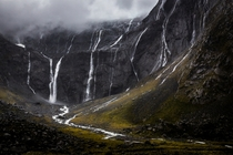 Waterfalls near the mouth of the Homer Tunnel New Zealand Photograph by Travis Daldy