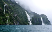 Waterfalls on a windy rainy day at Milford Sound NZ