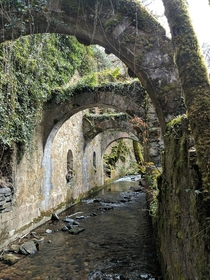 Waterway underneath an ancient ironworks Pyrenees Mountains Spain