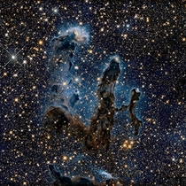 We all know the image of the Pillars of Creation taken by the Hubble telescope Here is a new image of NASA the pillars seen in infrared light that pierces through dust and gas and offers an unknown view