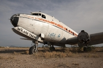 WE ARE THEM Abandoned airplane with graffiti near Airport Mesa AZ by Jrmy RONDAN