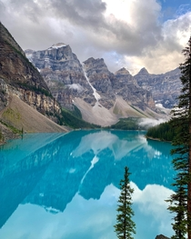 We got here just around sunrise to catch a very peaceful and not so crowded Moraine Lake Calm winds and no canoe or kayaks meant a perfect reflection of the Rockies in the lake Moraine Lake Alberta
