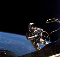 Wearing his Gemini Spacesuit Ed White leaves the Gemini IV capsule for the first American spacewalk on June