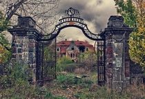 Welcome to the Gates of Hellplease step in inside and make yourself at home Abandoned palace in Poland Photo by Lukasz Malkiewicz
