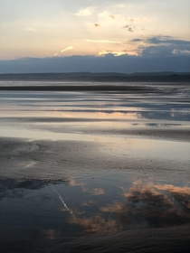 West coast of Ireland walked out on the beach in Liscannor and was blown away by the low tide and reflecting sunset