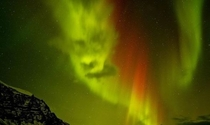 What looks to be a face in the Northern Lights above Iceland  Photographed by Tom Mackie