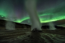 What spooky planet is this Planet Earth of course on the dark and stormy night of September  at Hverir a geothermally active area along the volcanic landscape in northeastern Iceland Geomagnetic storms produced the auroral display in the starry night sky