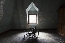 Wheelchair Inside an Abandoned State Hospital in New York