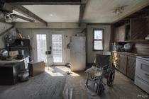 Wheelchair Sitting Inside the Kitchen of an Abandoned House in Rural Ontario Canada