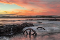 Wheels of Opportune Windang NSW Australia The wheels of an s trolley from construction of a failed harbour which started in the s standing amongst the beating of the ocean in a blistering sunset on the last day of Summer   IG jyeberryphoto