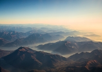 When you fly over the Alps remember to ask for a window seat The view is breathtaking This is the Y-shaped Como lake during a hazy sunrise