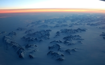 Where Greenland meets the frozen ocean at sunset Lucky view on a flight between Iceland and Canada