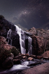 While camping at the Grampians National Park in Australia I captured this scene just before the full moon rose behind the falls