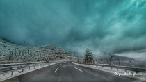 While driving just outside Tripoli Greece I was faced with a magnificent scenery of a snowstorm