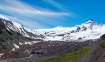 While hiking in Mt Rainier NP today a rainbow formed in the clouds over Little TahomaEmmons Glacier