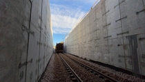 While still a work in progress the first train out of the Middlebury Tunnel This photo showcases just a handful of the  precast sections Project length of ft I work on the railroad aspect of the job photo is from Friday