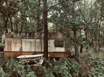 Whilst Having a walk deep in the woods in Somerset UK I came across this old abandoned caravan covered in moss It looks as if it was from the s It was quite unexpected and creeped me out a bit