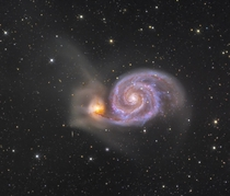Whirlpool Galaxy Deep Field -- A stunning pair of interacting galaxies NGC s right spiral arms and dust lanes clearly sweep in front of its companion galaxy left NGC