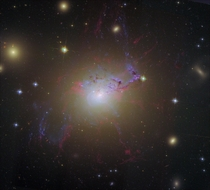 Wild-looking at visible wavelengths this active galaxy is a prodigious source of x-rays and radio emission NGC  accretes matter as entire galaxies fall into it ultimately feeding a supermassive black hole at the galaxys core