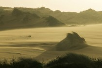 Wind blows over dunes at Guincho Portugal