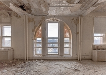 Window in a badly decayed room in an abandoned New York nursing Home OC - x