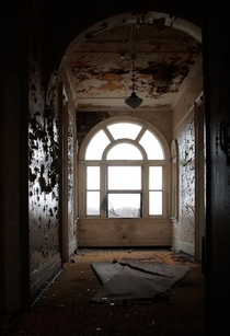 Window in an abandoned psychiatric hospital