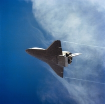 Wingtip vortices trail from STS- Space Shuttle Columbia as it lands at Edwards Air Force Base Nov