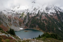 Winter erasing fall alpine colors as it descends on Doubtful Lake North Cascades WA