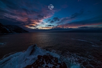 Winter sunset over the frigid Atlantic Ocean from Newfoundland Bottle Cove Newfoundland Canada