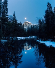 Wintry reflections of Half Dome with a full moon rising above it in Yosemite National Park  x