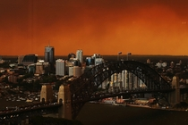 With dozens of wildfires raging outside the city an orange haze descended on Sydney today