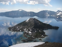 Wizard Island is a volcanic cinder cone which forms an island at the west end of Crater Lake in Crater Lake National Park Oregon it also happens to look like a gigantic arrow