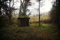 Woodern hut behind a derelict manor   x